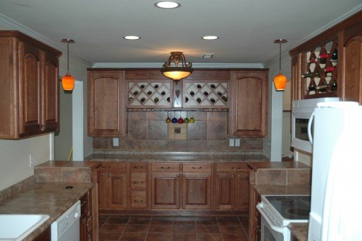 A wine rack over a set of regular cabinets turned this space into a serving area for entertaining.