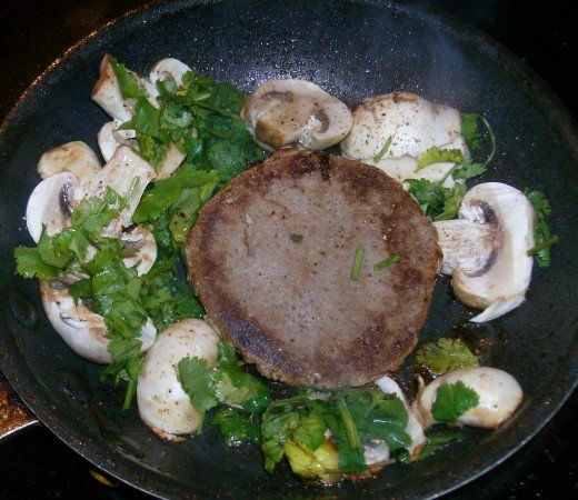 Mouth-watering turkey burger cooking up with mushrooms and cilantro. And I never leave out the garlic!