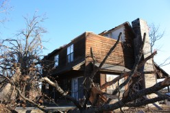 The roof is gone on the rest of the house and more trees uprooted and blown over.