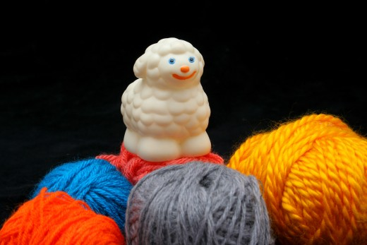 SHEEP OVER BALLS OF YARN by Erdosain DESCRIPTIONWhite sheep over balls of yarn. Concep: before and after