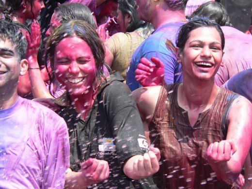 Girls and boys enjoying wet holi