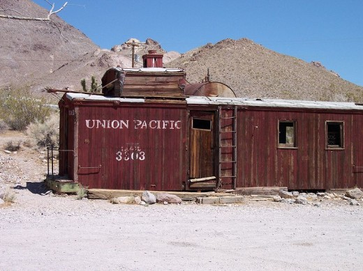An abandoned Caboose in the ghost town of Ryholite.