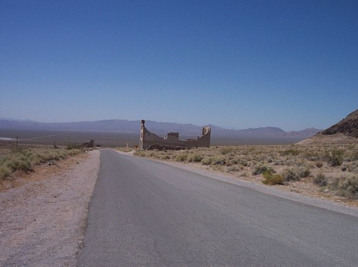 """Ruins"" of an old building in the ghost town of Rhyolite, Nevada... the road leading to Rhyolite."