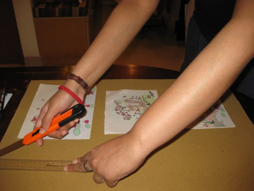 The cardboard is carefully cut to make a base for pasting the artwork on, using a good cutter and ruler.