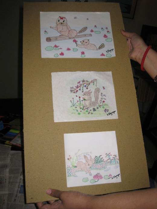 You can paste any number of pictures on the cardboard-base, leaving some space for decorative purposes later.