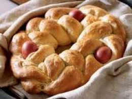 Another Easter Treat - pletenica.  Made from sirnica dough, it's a braided bread with uncooked eggs positioned within it, which cook during the baking process.  Some lucky children receive their very own (smaller) pletenica on Easter morning!