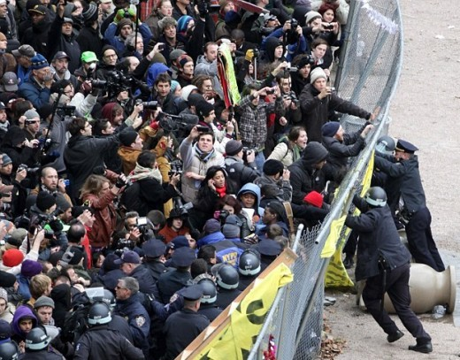 "Police try to contain Occupy Wall Street protesters behind ""protest pen"", December 2011."