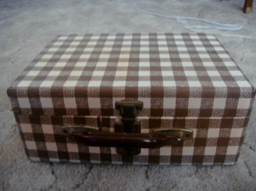 Suitcase covered with contact paper
