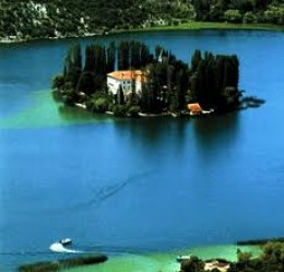 Visovačko Jezero (Visovačko Lake) located at the base of Krk Waterfalls in Croatia.  Two seminaries from the Middle Ages, Franciscan and Eastern Orthodox, are located on this tiny island.