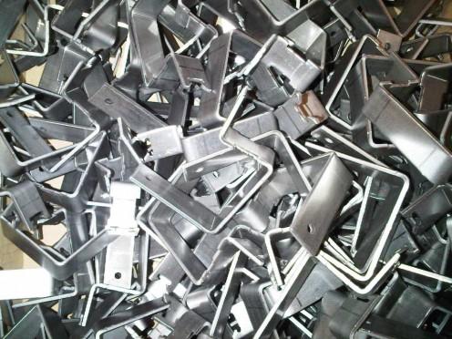 3mm thick mild steel brackets.  These ones are used to hold up light fittings on track systems for exhibition stand lighting.