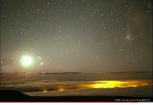 Here Nibiru is shown with its orbiting planets another interesting photograph.