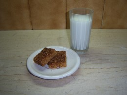 Chewy honey, oat and coconut flapjacks with a cold glass of milk....