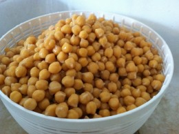 Garbanzo beans (chickpeas) being drained and rinsed after soaking