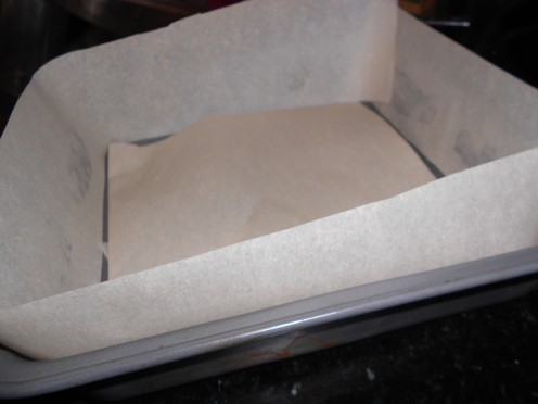 "Line an 8"" square baking pan with parchment paper, butter sides to hold paper and leave a 3/4"" collar"