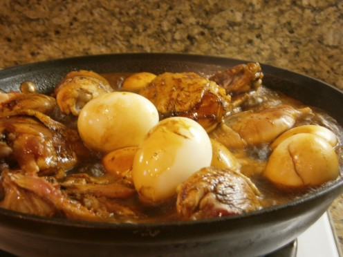 Simmering brings all the flavors together and thickens the broth to coat chicken and eggs. Don't forget to stir it from time to time so it doesn't stick to the bottom of pan.