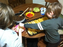 Both my children helped with assembling the tacos, here they are adding the cheese to melt in the oven