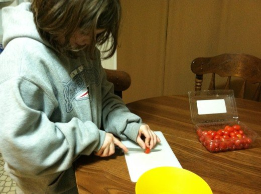 Teaching children how to safely use a knife, will help older kids be able to help with tasks like dicing tomatoes