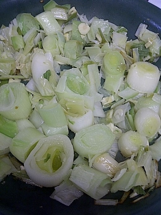 Saute leeks with garlic in olive oil