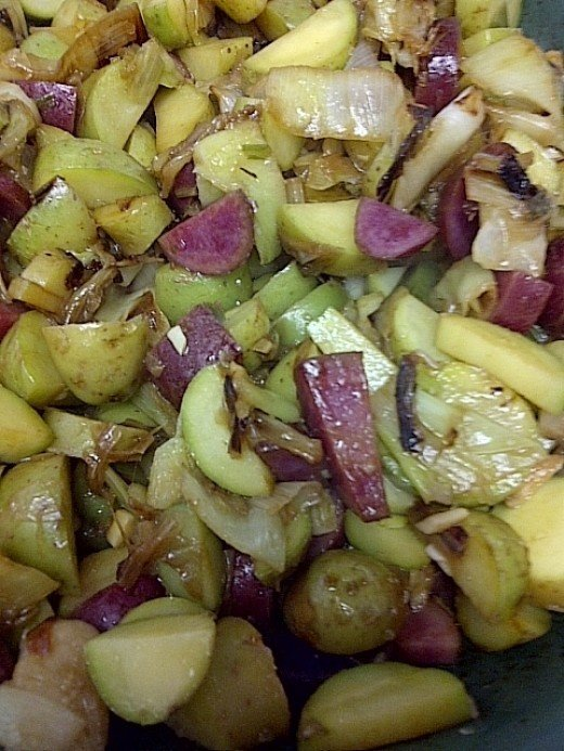Add the potatoes to the leek and garlic mixture and cook til onions start to carmelize