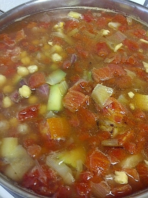 Simmer the vegetables with the tomato and beans before adding the spices.