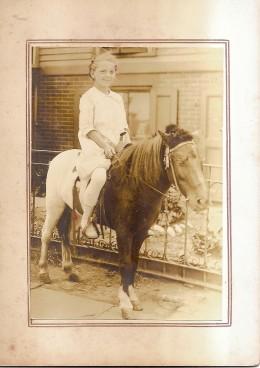 My aunt riding a pony.