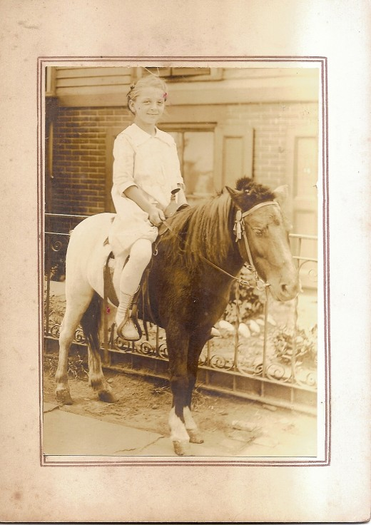 My aunt riding a pony.