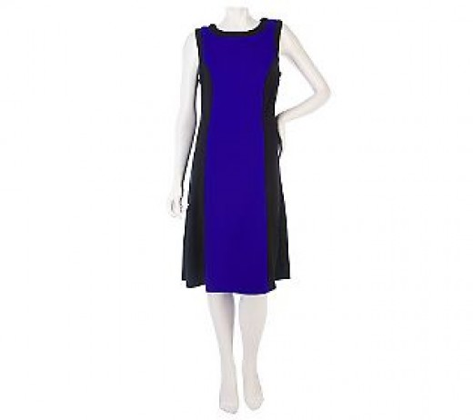 A slimming colorblock dress in purple with black sides.
