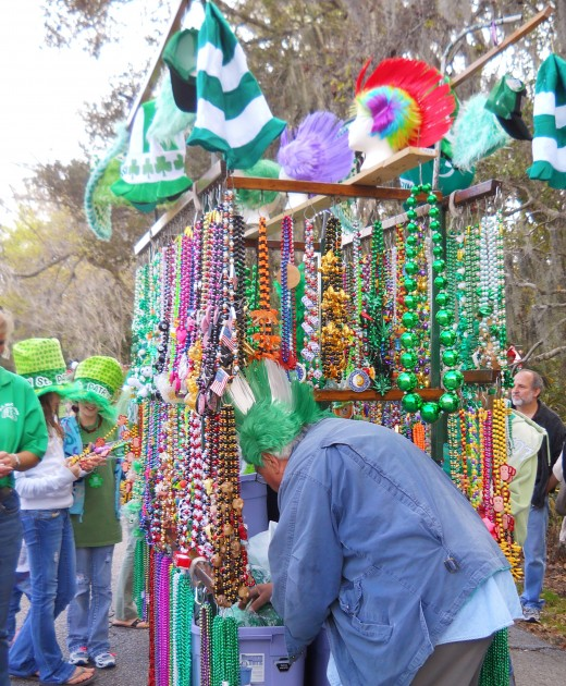 Vendor selling Mardi Gras style beads, hats and head pieces in St. Patrick's Day colors.