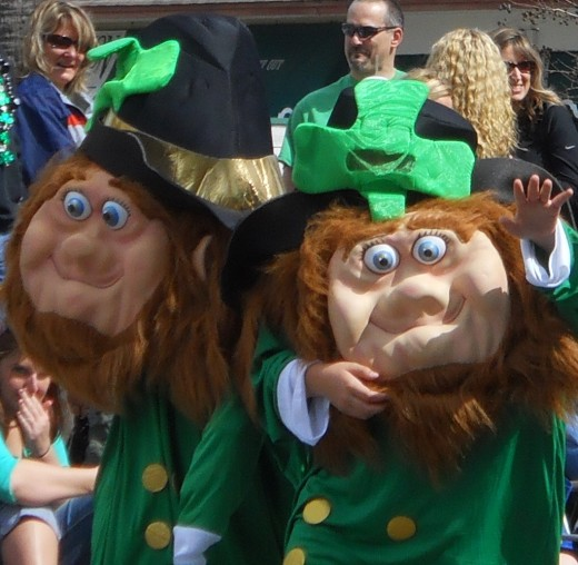 Leprechauns lead off the parade waving to thousands of spectators along Pope Avenue.