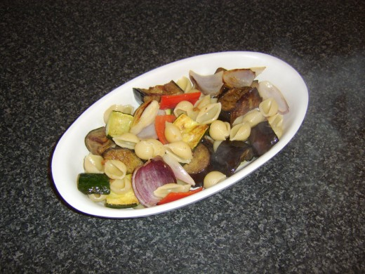 The pasta and vegetables are carefully laid in a serving dish