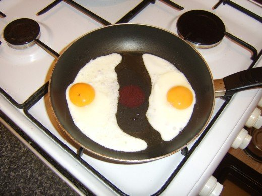 The eggs are fried in a separate pan