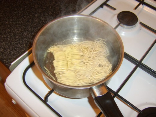 Dried noodles are added to boiling water to rehydrate