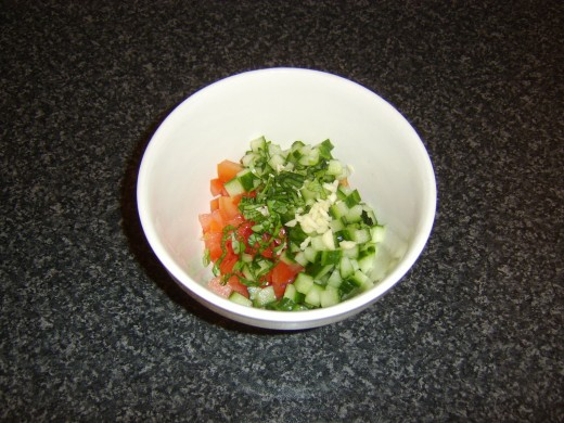 Salsa ingredients are added to a mixing bowl