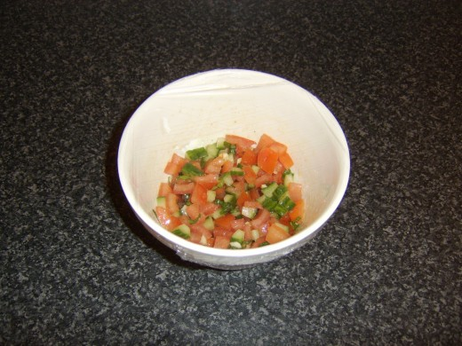 Salsa is covered with plastic wrap and refrigerated until required