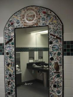 Full length mirrors are framed with ceramic tiles.