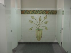 Each bathroom has a different theme with different artwork. This room displays hand-painted tile art.