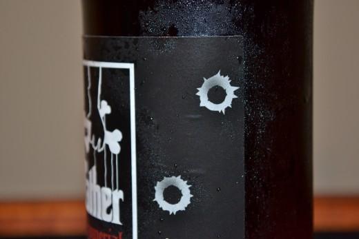 bullet holes in a bottle?