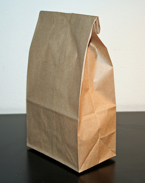 The small and unassuming brown paper bag will hold five found objects.