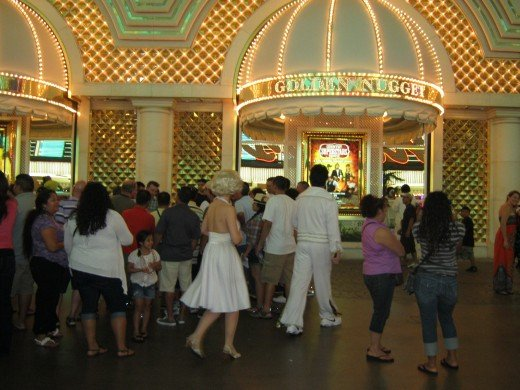 """Marilyn"" and ""Elvis"" walking along Fremont Street in Las Vegas."