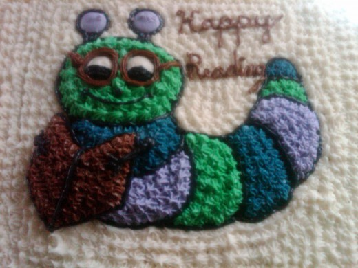 Finished cake. Made caterpillar as A Bookworm.