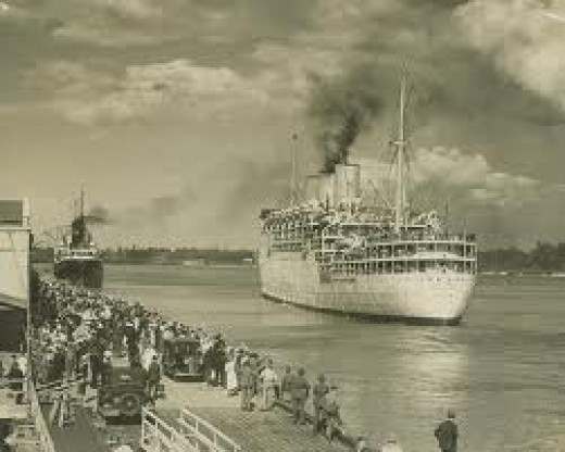 Old port of Brisbane, this is more or less the way the Port of Brisbane was when I came to Australia. There you can see people on the dock fare welling their friends on a ship leaving port; this was a way of life that we lived around the sixties.