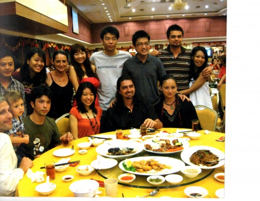 Happy group at dinner in Chinese restaurant.
