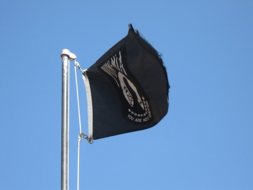 POW/MIA Flag Flying over aircraft memorial at Davis-Monthan AFB