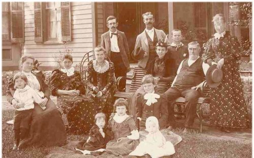 Bessie Bruford & her aunt SophiA Window-Filley's family in the side yard of the Filley home on the west side of Burlingame KS, late summer or early fall 1893.