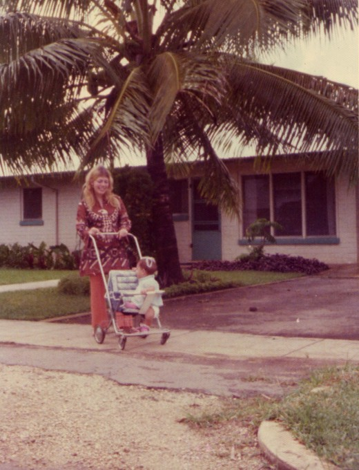 In my new home in Tonga with my baby. This picture was taken at Liahona Campus, the school where we lived for several years.