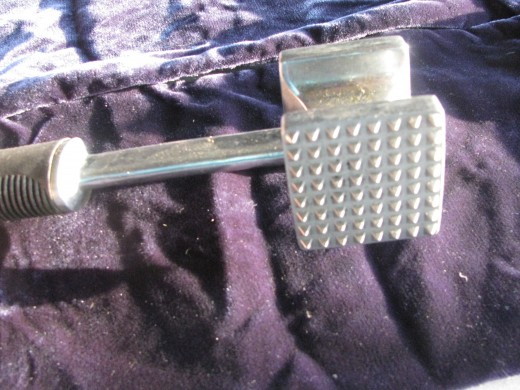 Meat tenderizer - I like the metal ones better than the wooden ones.  I think they're more sanitary and easier to clean.