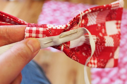 Attach a ribbon or elastic to the back of the bow