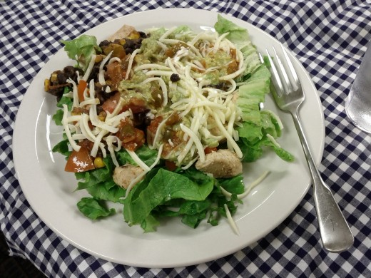 Roast chicken and vegetables with mozzarella on salad