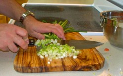 Chopping onions for yellow pepper salsa.