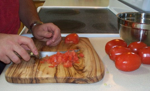 Dicing tomatoes for a fresh tomato salsa.